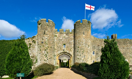 Amberley Castle in spring, flying England flag of Saint George, West Sussex England UK.