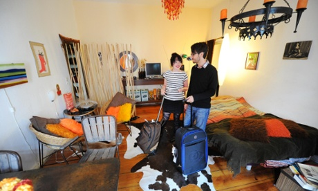 A couple arrive in their Airbnb apartment - but peer-to-peer holiday rentals are just the beginning