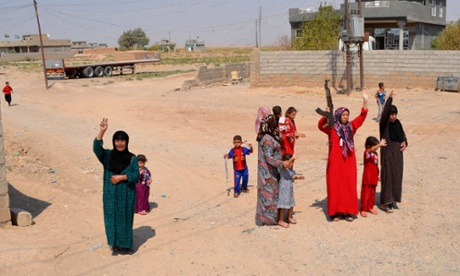 Local residents welcome Iraqi government forces as they arrive to deliver the humanitarian supplies.