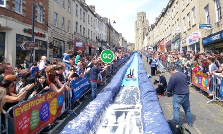 Luke Jerram's crowdfunded Park and Slide project temporarily transformed Park Street in Bristol into a giant water slide