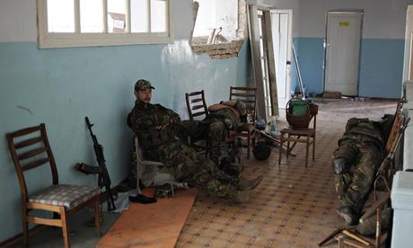 Ukrainian servicemen rest in a school building in the devastated eastern Ukrainian town of Ilovaysk near Donetsk. Photograph: Stringer/REUTERS