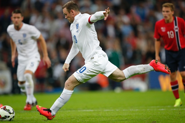 Rooney slams home the spot kick with venom to give England the lead.