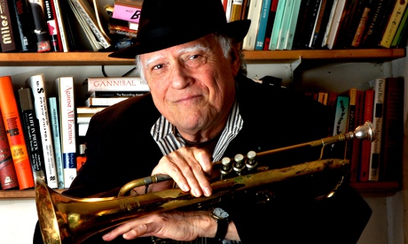 Writer and musician Mike Zwerin poses with his bass trumpet