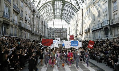 Chanels Karl Lagerfeld cheered and jeered for feminist fashion statement