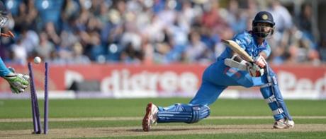 Shikhar Dhawan is bowled by Moeen Ali.