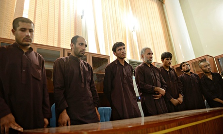 Seven men sentenced to death for the gang-rape of four women, at court in Kabul.