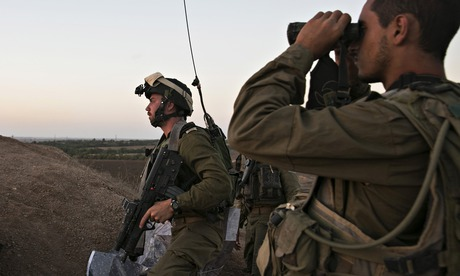 Israeli soldiers at an observation post overlooking the Gaza Strip last month