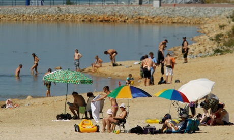 Bathers enjoy the water at a beach at Bärwalder See lake near Boxberg, Germany.