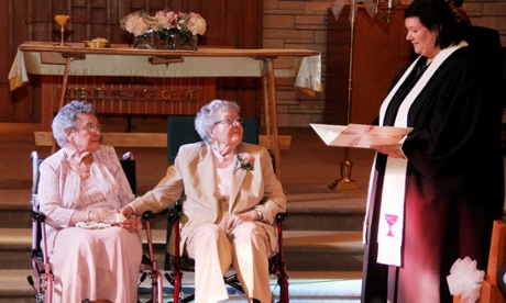 Reverend Linda Hunsaker presides over the wedding of Vivian Boyack, left, and Alice  Dubes, center, in Davenport.
