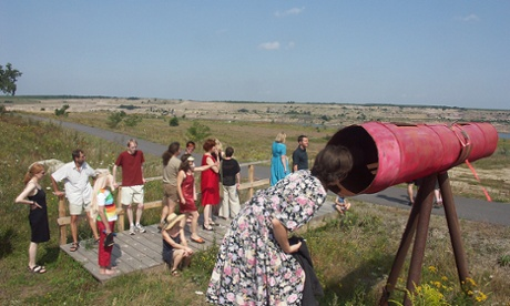 Families enjoy landscape art near Pritzen.