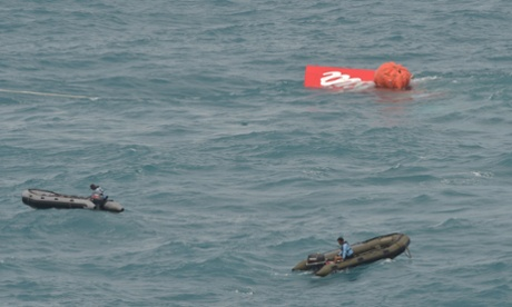 Part of the tail of AirAsia flight 8501 comes to the surface as the Indonesian navy continues the search for wreckage.
