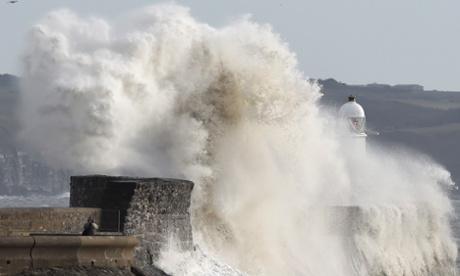 Man dies as storms lash UK
