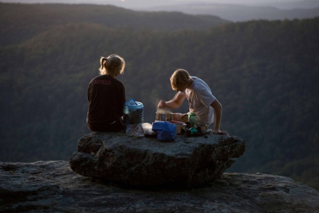 A couple cooking a camping dinner, Ozark Highlands Trail. Arkansas
