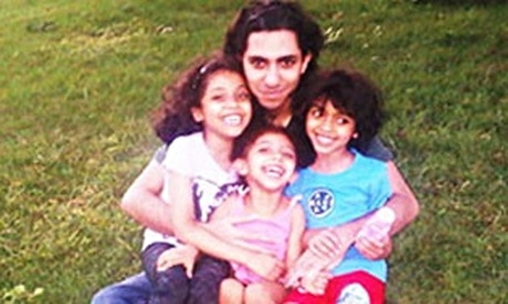 Saudi blogger's wife says global pressure could force his release