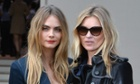 Cara Delevingne and Kate Moss attend the Burberry Prorsum show.