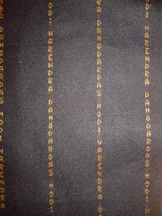 Detail of Narendra Modi's pinstripe suit.