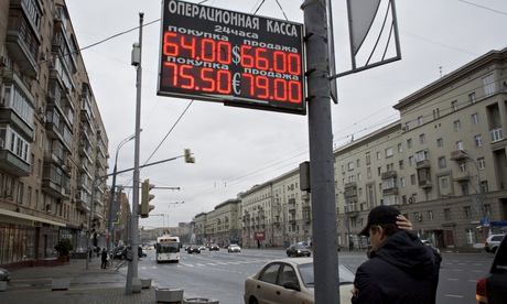 Russia downgraded to junk status for first time in decade...