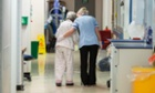 A health worker and patient on a ward in Addenbrooke's hospital in Cambridge