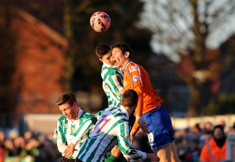 Birmingham City's Nikola Zigic  beats Jordan Watson of Blyth Spartans to the ball but the score remains 0-0.