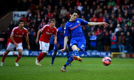 Rochdale's Peter Vincenti of Rochdale scores from the penalty spot, sending Forest's Dorus De Vries the wrong way.