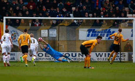 Robbie Simpson has his penalty saved but follows up to score the rebound to make it 1-0 to Cambridge United.