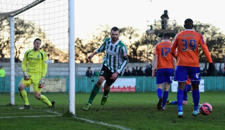 Blyth Spartans' Robbie Dale celebrates after scoring from a Rivers' cross and the upset is on.