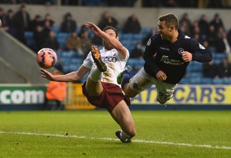 Millwall's Scott McDonald heads the equaliser against Bradford.