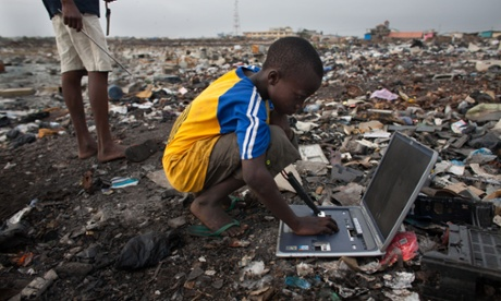 Electronic waste in Agbogbloshie dump, Accra, Ghana. E-waste trash pickers risk their health in search of metals they can sell.