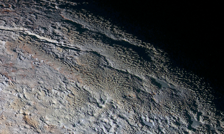 Images of Pluto and Charon continue to captivate Nasa: 'This world is alive'