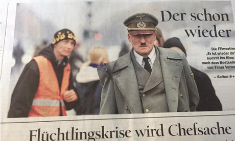 German paper says sorry for Hitler image above refugee crisis story