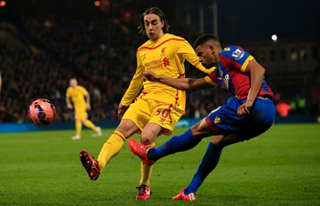 Lazar Markovic tries to block a cross from Fraizer Campbell; Palace on top so far.