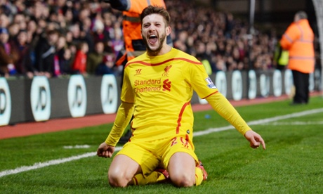 Adam Lallana celebrates after scoring to put Liverpool ahead.