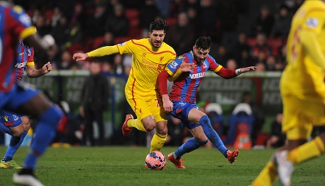 Emre Can battles for the ball with Joel Ward.