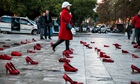 lots of pairs of red shoes in an art installation in Palermo
