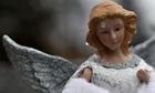 Rain drops on a figurine of an angel