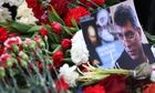 Flowers were laid at the spot where Russian politician Boris Nemtsov was shot dead on Friday.