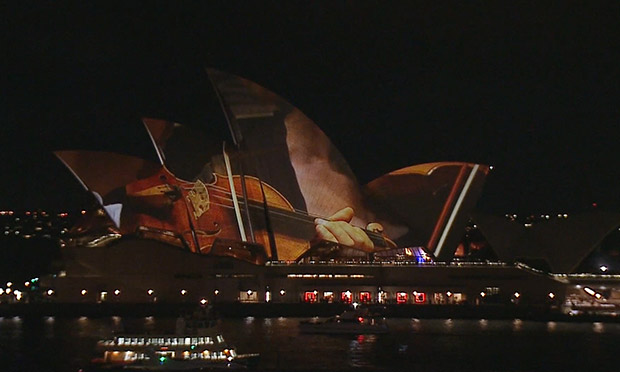 Sydney opera house projects live orchestra on its sails for House music orchestra