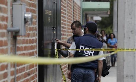 Ten killed in suspected drug cartel ambush on police convoy
