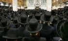 Followers of ultra-orthodox Jewish Rabbi Moses Teitelbaum of the Satmar Hassidim pack the Congregation Yetev Lev D'Satmar in the town of Kirays Joel, New York, April 25, 2006, during a funeral service fo