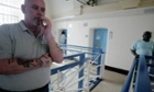 A prisoner smokes on a landing in Wandsworth prison