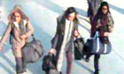 CCTV picture of Amira Abase (left) Kadiza Sultana (centre) and Shamima Begum (right at Gatwick airport, before they caught their flight to Turkey.