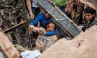 A woman is rescued from the ruins of the 19th-century Dharahara Tower in Kathmandu