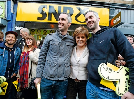 Nicola Sturgeon posing outside the SNP shop with tall twins