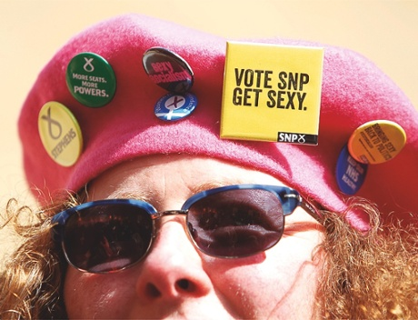 A female activist with badges on her beret at the launch of the SNP Women's Pledge