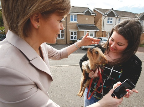 Nicola Sturgeon with a woman and a dog