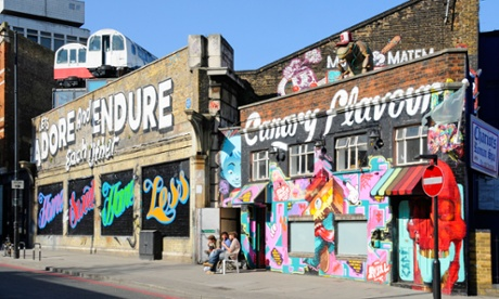 Graffiti and old tube trains on the outside of Village Underground, Shoreditch