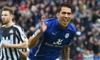Leonardo Ulloa celebrates scoring the third goal for Leicester from the penalty spot, his second of the game.