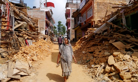 A woman walks along the ruined streets of Chautara municipality, Sindhupalchok district.