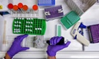 A scientist prepares protein samples during research into cancer