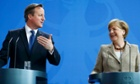 German chancellor Angela Merkel and British prime minister David Cameron after their meeting in Berlin on Friday.